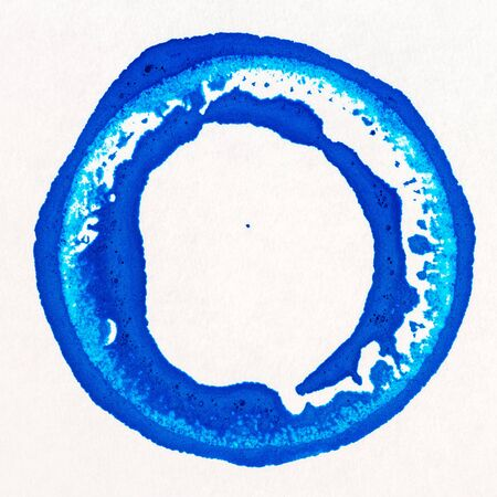 vibrant: Vibrant blue acrylic paint circle on white paper