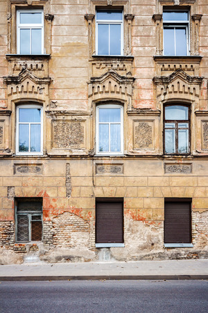 louver: Abandoned weathered street wall with some windows