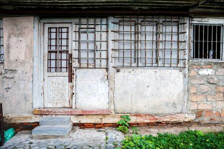 boarded up: Boarded up window and old door of a old house