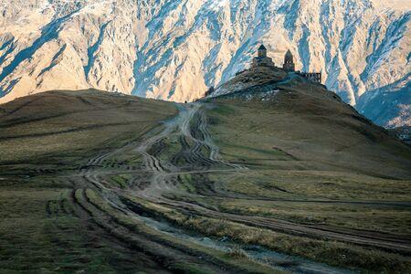 georgian: Gergeti  Tsminda Sameba church in georgian mountains
