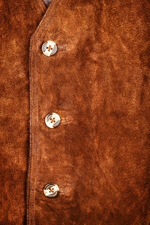 suede: Fragment of brown suede vest Stock Photo