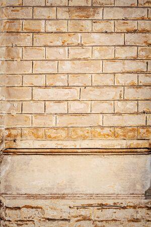 yellowish: Texture of yellowish brown rough brick wall Stock Photo