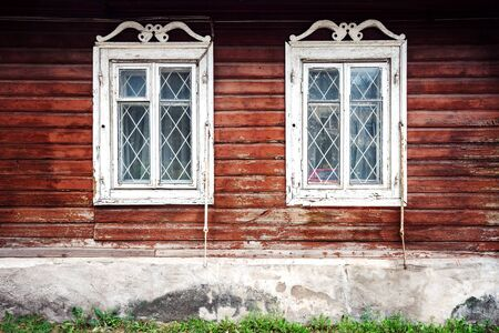 old windows: Old windows on a aged wooden wall Stock Photo