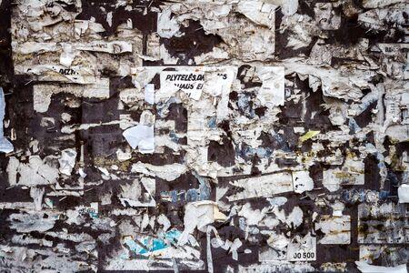 Scraps of paper on old bulletin board