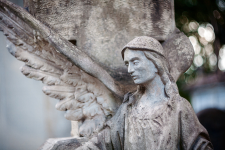 angel cemetery: Old concrete statue of angel at Rasu cemetery in Vilnius Lithuania. Shot taken with a soft focus lens, shallow depth of field.