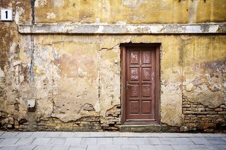 Ancient door of a abandoned house photo