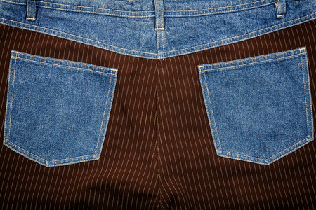 fabric textures: Jeans and lined brown fabric textures with jeans back pockets Stock Photo