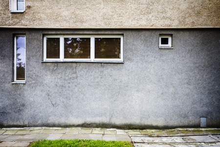 window graffiti: Aged weathered street wall with some windows Stock Photo