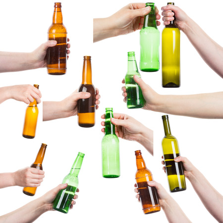 green glass bottle: Collection of female hands holding various bottles of alcohol isolated on white background