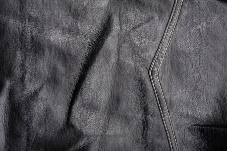seam: Crumpled worn leather texture with a seam