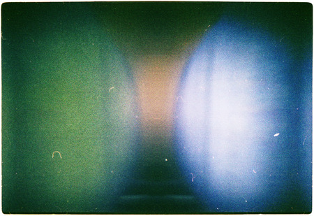film: Designed green blue and yellow colors film texture background with heavy grain, dust and light leak