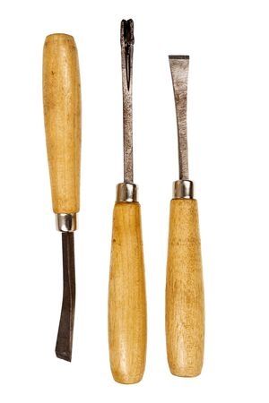 chisels: Three used chisels isolated on white background. Stock Photo