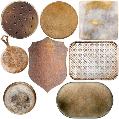 shield: Collection of old metal plates isolated on white background