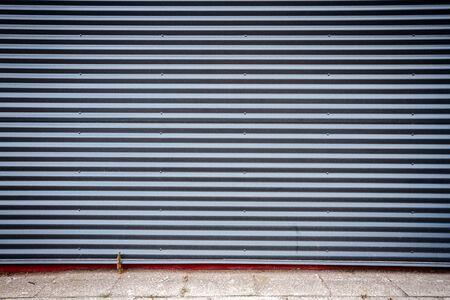 grooved: Dark gray industrial grooved metal wall
