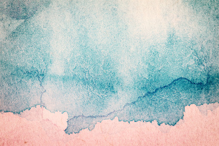 Abstract hand drawn blue and pink watercolor background