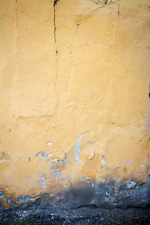 aged: Aged weathered yellow wall background