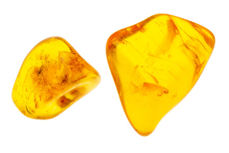 Two pieces of amber isolated on white background