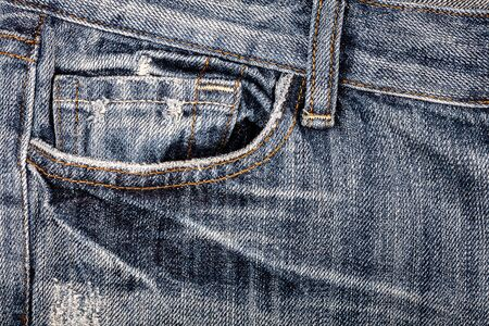 worn jeans: Blue worn jeans fabric with pocket background Stock Photo
