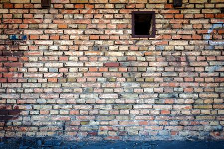 window graffiti: Yellow brick wall with one small window