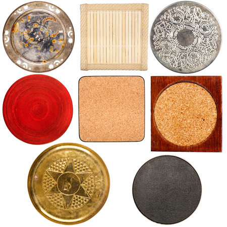 red label: Collection of various vintage table coasters isolated on white background