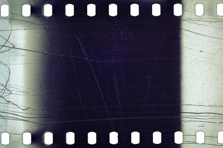photographic film: Blank noisy scratched film strip texture background