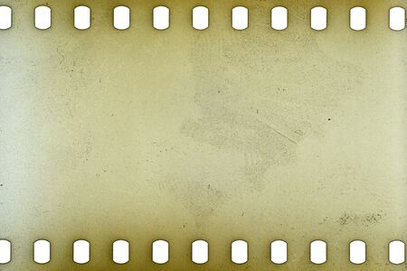 black textured background: Blank yellow vibrant noisy film strip texture background Stock Photo