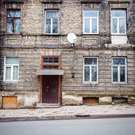 windows and doors: Old weathered street wall with some windows and doors Stock Photo