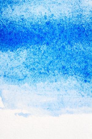 抽象的な手描き水彩絵の具の青背景 写真素材
