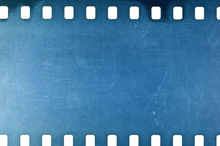 blue film: Blank crumpled noisy blue  film strip texture background