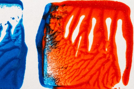 Closeup view of abstract hand painted blue and red acrylic art background on paper texture Stock Photo
