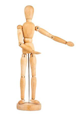 marioneta de madera: muñeco de madera que muestra la dirección aislado en un fondo blanco Foto de archivo