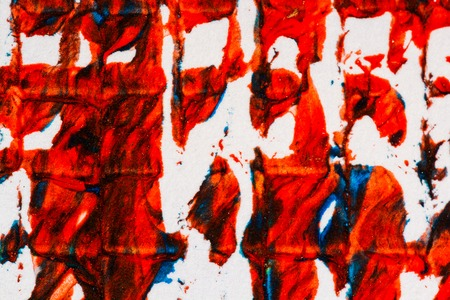 Closeup view of abstract hand painted mainly red acrylic art background on paper texture. Fragment of artwork