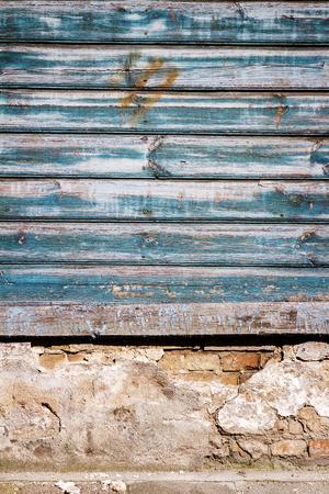 Peeling blue paint on weathered wood wall Stock Photo