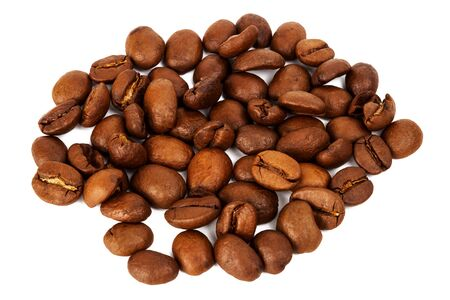 Pile of roasted coffee beans isolated in white background, selective focus on the center Stock Photo