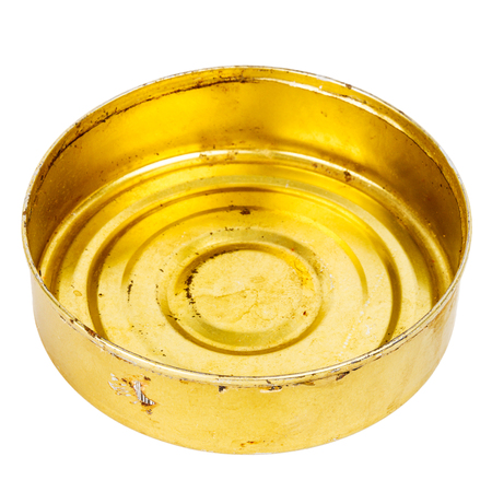 Grungy round yellow metal tin can isolated on white Stock Photo