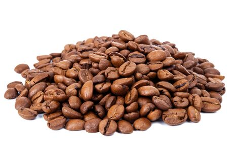 the daily grind: Pile of roasted coffee beans isolated in white background, selective focus on the center Stock Photo