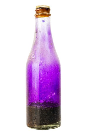 potassium: Old dirty dusty bottle with potassium permanganate isolated on white background