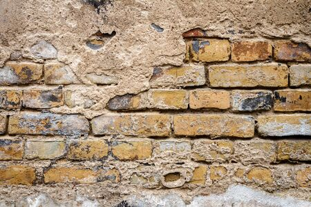 revetment: Background of old yellow brick wall texture, abstract horizontal architecture wallpaper Stock Photo
