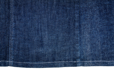 Piece of dark blue jeans fabric isolated on white background. Stock Photo