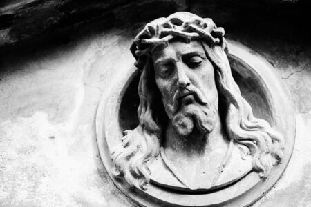 resurrect: Face of Jesus Christ on old tombstone. Black and white image