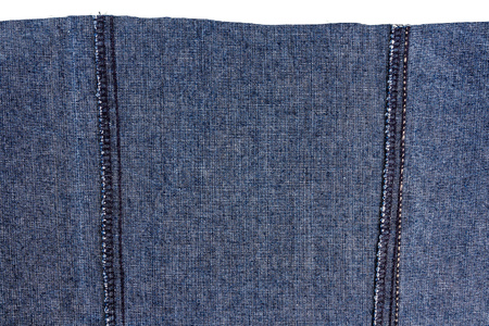 Piece of dark blue jeans fabric isolated on white background. Rough uneven edges. Wrong side of fabric Stock Photo