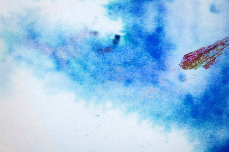 Macro shot of abstract hand drawn blue and magenta watercolor paints background. Stained texture Stock Photo