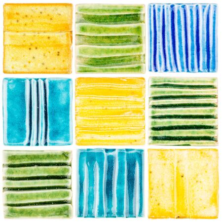 Collection of lined handmade glazed ceramic tiles isolated on white background Stock Photo