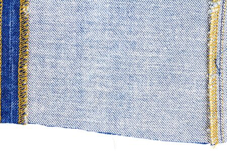 Piece of blue jeans fabric isolated on white background. Rough uneven edges. Wrong side of fabric Stock Photo