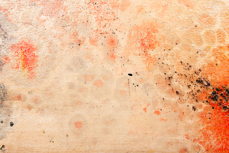 Yellow brown and red messy wall stucco texture background. Decorative wall paint.