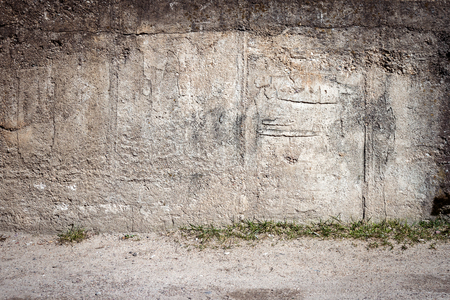 Aged weathered cracked concrete wall background Stock Photo