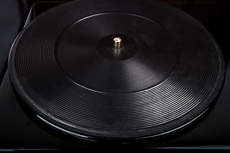 Close up shot of old turntable rubber platter with the spindle Stock Photo