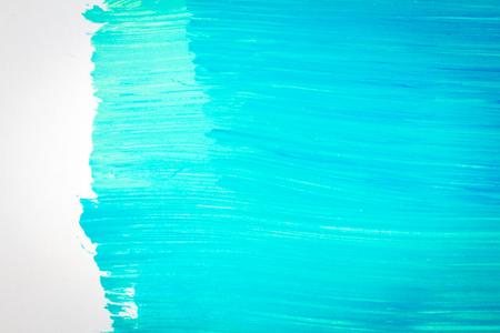Abstract brushed cyan hand painted acrylic background, creative abstract hand painted background, close-up fragment of acrylic painting on paper with brush strokes