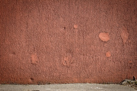 Aged weathered vibrant red street wall background