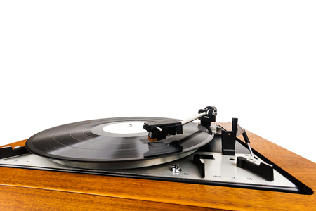 Close up of vintage turntable vinyl record player isolated on white. Wooden plinth. Retro audio equipment. Фото со стока